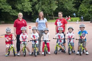 Children learn cycling skills as part of summer holiday campaign